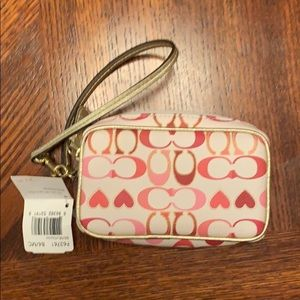 Authentic Coach multi pouch with wrist strap.  NWT